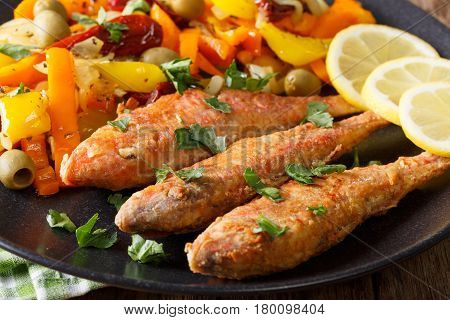 Fried Mullet With Stewed Vegetables And Lemon Close-up. Horizontal