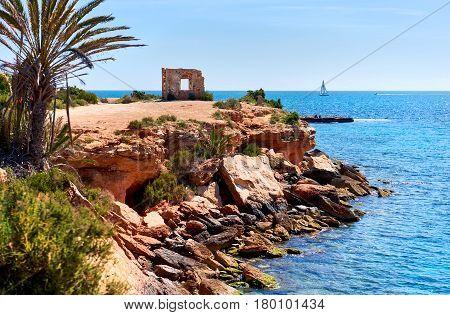Rocky coastline of Punta Prima. Province of Alicante. Southern Spain