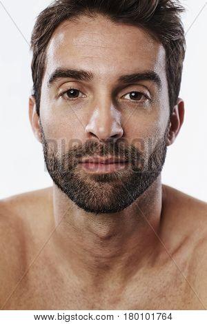 Handsome guy with stubble portrait studio shot