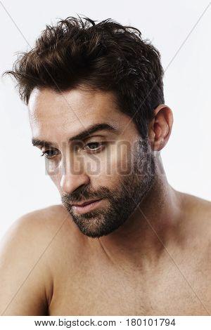 Handsome man with stubble studio shot close up