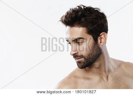 Dude looking away in white studio shot