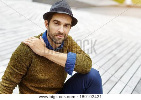 Fashion guy in hat looking at camera