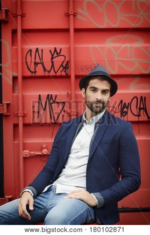 Dude in front of cargo container portrait