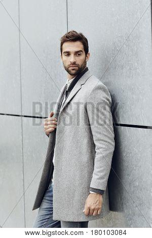 Trendy Smart looking coat guy looking away