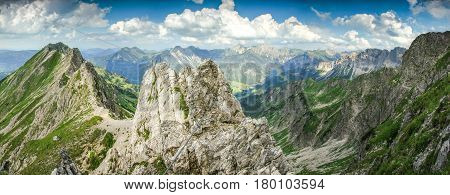 Fixed rope route in the mouintains. Very exposed, great panoramic view. Morning or evening light in the mountains. Climbing in the mountains. Alps, Germany, Bavaria.