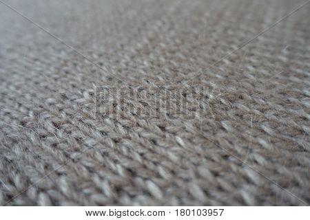Close-up of grey handmade plain knit stitch fabric