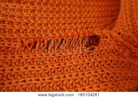 Close up of tear in knit fabric