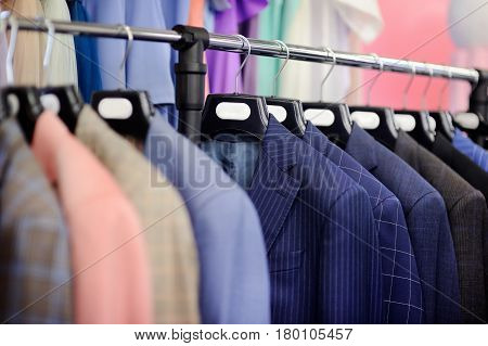 Style Wedding Suits On A Hanger