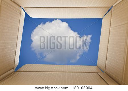 View from inside a cardboard box. Cloud and the sky outside the box. Freedom concept.