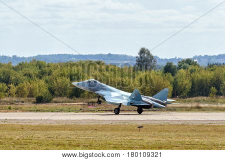 MOSCOW REGION - AUGUST 28, 2015: New Russian fifth-generation fighter T-50 (Sukhoi PAK FA) lands at the International Aviation and Space Salon (MAKS) in Zhukovsky.