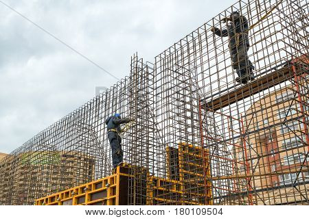 MOSCOW - APRIL 3: Construction site workers on april 3, 2014 in Moscow, Russia. Urban construction is at a faster pace in Russia.