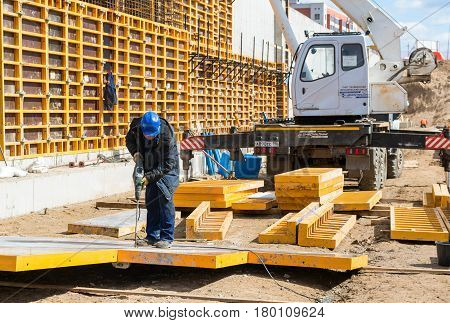 MOSCOW - APRIL 24: Construction site worker on april 24, 2014 in Moscow, Russia. Urban construction is at a faster pace in Russia.