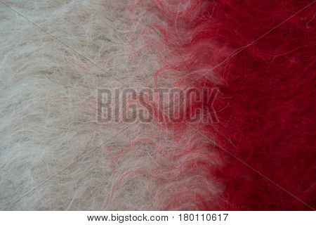 Close-up of handmade woollen felt blanket in white and red