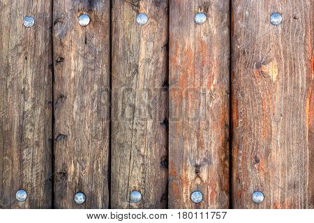 Old wooden fence with rivets wood texture