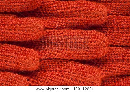 Knitted fabric of red color close-up. Weave braid