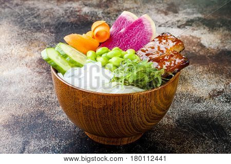 Vegan tofu poke bowls with seaweed watermelon radish cucumber edamame beans and rice noodles. Copy space background