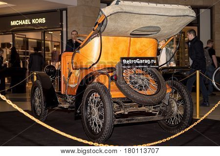 Moscow Russia - April 02 2017: Opel 4/8ps doctor's car Germany 1909. Side view. Retro car exibition in shopping mall Metropolis.