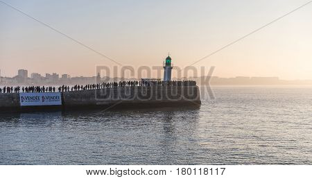 LES SABLES D'OLONNE, FRANCE - JANUARY, 20, 2017 : Spectators waiting the skipper Alex Thomson for the second place of the Vendee Globe race (Yacht race) on the little jetty of Les Sables d'Olonne.