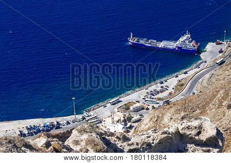 Top view of a huge catamaran on the island of Santorini