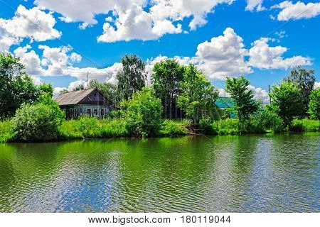 Russian village houses on the lake shore on a summer day