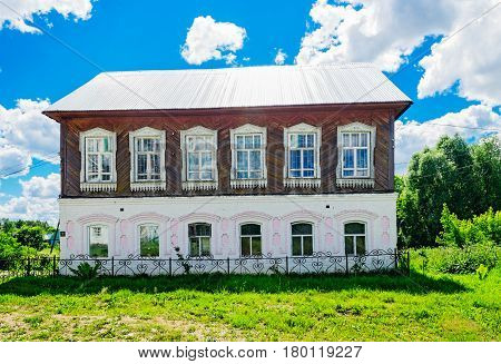 Big russian village house on a summer day