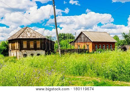 Old russian village houses on a summer day