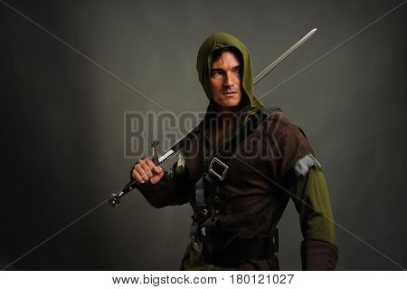 The enchanting photo shows a man holding a sword