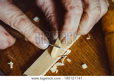 the hands of the craftsmen carved wooden product