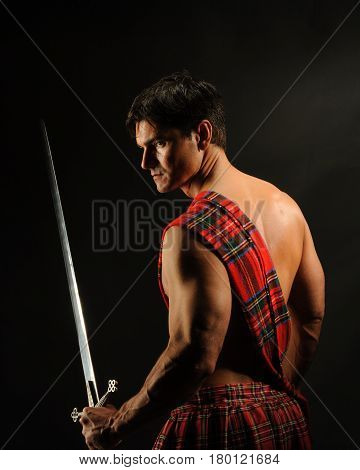 The tough warrior stands with his sword