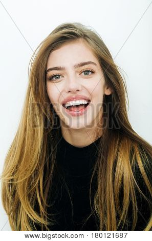 Happy pretty girl or beautiful woman with long blond hair hairstyle in black clothes smiling on white background