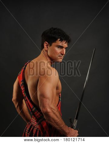 The sexy highlander is awaiting his call for battle.