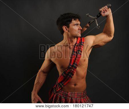The defiant highlander raises his sword for battle.