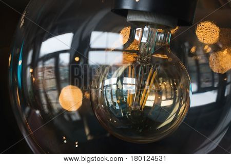 Incandescent lamps in a modern cafe a diode thread of a modern energy-saving light bulb. Lamp of Edison.