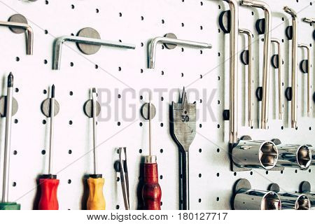 Various tools for working on aluminum surfaces on the wall