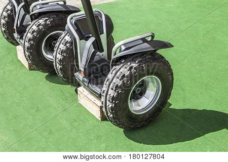 Two segway vehicles with special tyres for nature routes by trails and paths