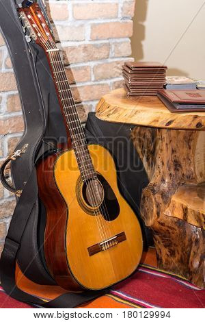 Accoustic Guitar By The Brick Wall