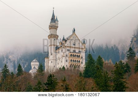 The famous German castle Neuschwanstein under dramatic sky. Germany. Bavaria.