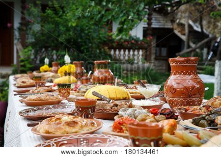 table with homemade moldavian food in clay dishes