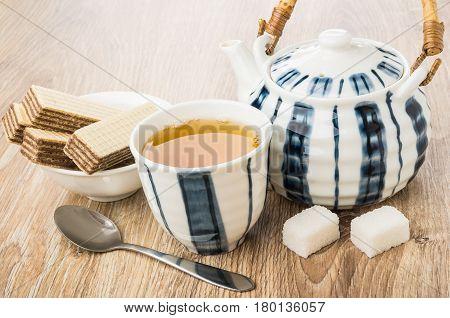 Tea, Wafers In Bowl, Teapot, Lumpy Sugar And Spoon