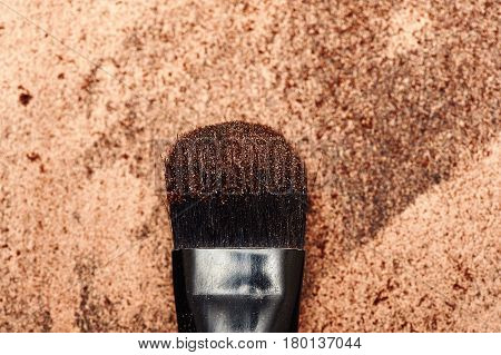 Macro Make-up Brush with golden Eye Shadow on Bristles and Background
