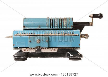 Old blue calculating machine isolated on a white background. Front view.