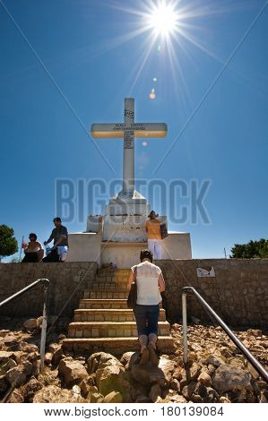 Medugorje (Medjugorje), Bosnia and Herzegovina - June 17, 2012: The cross on the top of Mount Krizevac in Medjugorje, many unidentified pilgrims reaching the top daily.