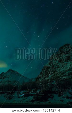 Aurora Borealis Known as Nother Lights Playing with Vivid Colors Over Lofoten Islands in Norway.Vertical Image Orientation