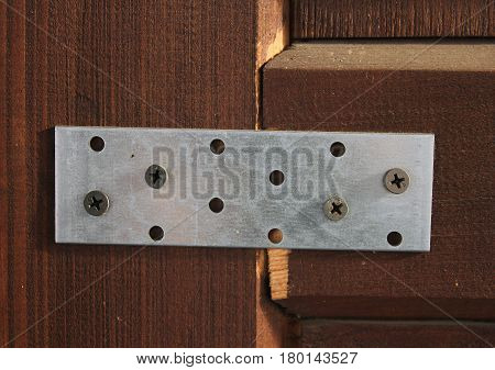 galvanized mounting plate is a metallic product used when designing buildings and structures of different types in the construction of houses made of wood