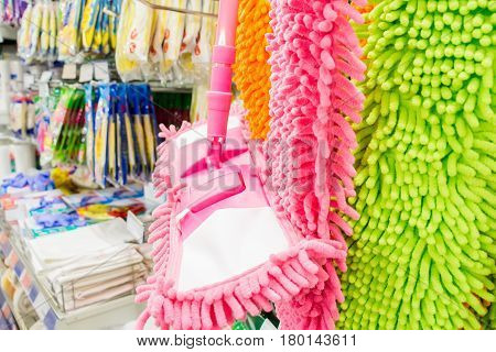 Closeup of colorful clean mops in shop