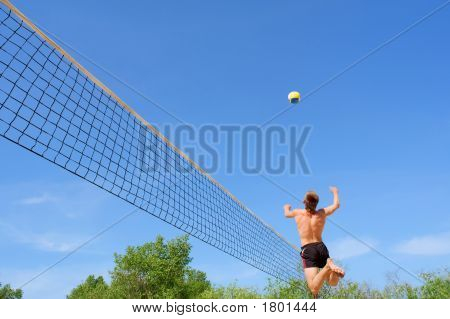 Teenager Plays Beach Volleyball - High Jump With Strike