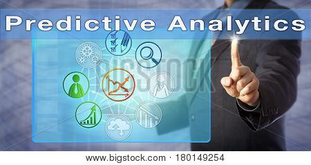 Blue chip business coach in dark suit is lecturing on Predictive Analytics. Information technology management metaphor and business process concept for effective data extraction and analysis.