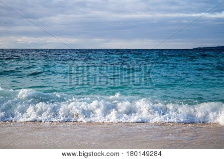 View of the waves from the sandy beach.