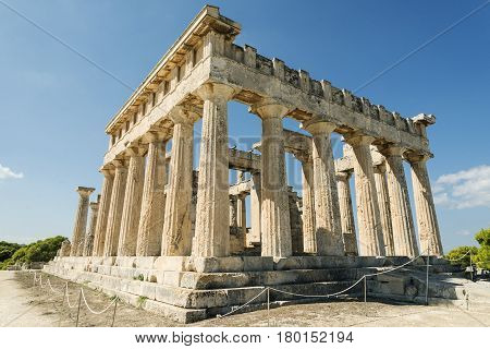 temple on the Island of Aegina in Greece on blue sky background