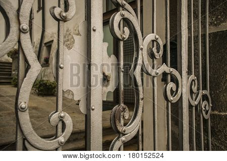 Detail of a lock of an old wrought iron gates worked by hand.